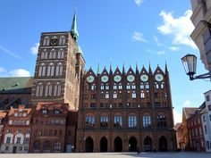 https://flic.kr/p/doFjWX | The town hall of Stralsund / Stralsunder Rathaus (Germany, Unesco WHS) |  Buy this photo on Getty Images : Getty Images  The 14th-century town hall of Stralsund is located in front of the west facade of St Nicholas Church and forms a unique synthesis of great variety. The town hall with its outstanding decorated brick elevation facing the old market is the most eloquent example of Sundische Gothik. The building has also some important Baroque additions, such as…