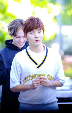 Seungkwan looking like he just won something and Vernon looking as if he just read the sweetest message ever