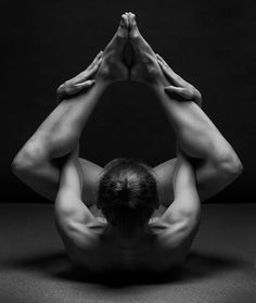 A beautiful photo taken of the Seal, a classical Pilates matwork movement.  photo credit: Anton Belovodchenko