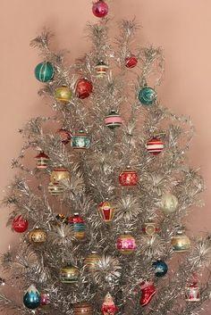 Super Cute Retro Silver Christmas Tree. #christmastree #christmastrees #christmasdecor #christmastreetheme #christmastreecolors  #christmasdecorations #deckthehalls #christmasspirit #GeneralChristmas #christmastreeornaments #christmastreetopper #Christmastreedecor #christmastime