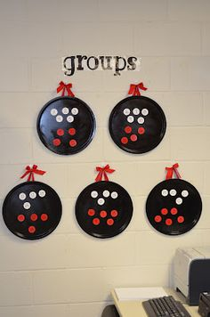 Using Pizza Pans and round magnets to organize groups.  Use student numbers, and then you can use every year.