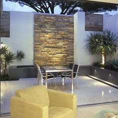 Gorgeous small courtyard with reflective surfaces, interesting textures and subtle lighting