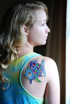 """I love the shiny scale... """"This is my Rainbow Fish tattoo inspired by the illustration from the children's book """"The Rainbow Fish"""" by Marcus Pfister. A humongous thanks to my artist, Nick Stambaugh, at the new Aces High Tattoo location in my hometown Jupiter, Florida. He was the mastermind behind the watercolor effect as it translated to skin."""""""
