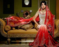This is my ideal wedding dress. It's a lenhga which is a two piece outfit with a long flowing skirt. I wouldn't want my skirt to be figure hugging because I would like to sit down without it splitting. I love the red & silver colours with the details.