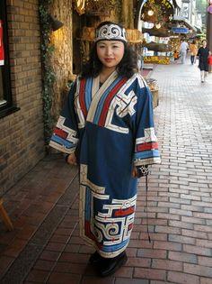 Ainu girl wearing traditional robe