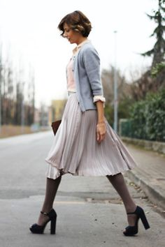 Pleated skirt/cardigan combo, always in good taste.