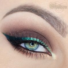 Sleek. Green liner on top and gold liner at the bottom. Earth or purplish tone on the rest of the upper lids
