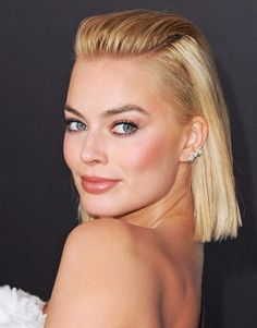 """Margot Robbie just shared the most genius beauty trick. """"My friend taught me this trick that I use every day. When I put on foundation, I use an eyebrow brush or toothbrush to brush it into my hairline so that it all blends,"""" she said."""