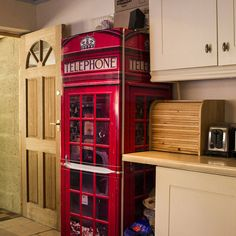 This is a premium vinyl cover for your refrigerator or freezer that transforms your appliance into a classic red British telephone box.Every FridgeWrap is available as vinyl supply only or as a product fitted by our team. Each is available in tall fridge freezer sizes, short freezer or fridge sizes, or custom double-door fridges