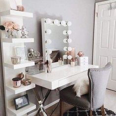 Create a glamorous look with sleek, white shelving and vanity, posh chair, and Hollywood mirror. Perfect for a teen girl's bedroom or shared space for siblings.
