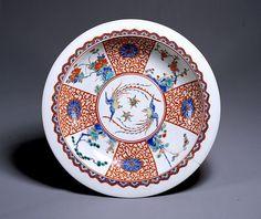 Large dish, imari-kakiemon type, Imari Ware.  Design of pine, bamboo, plum and peonies in overglaze enamels.