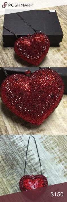 RED HEART CLUTCH. PERFECT FOR A VDAY GIFT NEVER WORN- Elegant Red heart clutch including a chain strap. Made with genuine Swarovski Crystals . Perfect for the holiday season and in perfect condition !! Bags