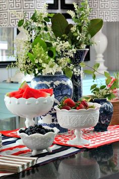 "love the white milk glass incorporated to decorate for the 4th! pulling in red, white and blue through your dishes, table linens and serving pieces is an easy way to give your table an instant summer feel. When you are planning a summer picnic or backyard BBQ, our color combo is as natural as corn on the cob and apple pie, they say ""summer."""