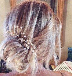 Pearls in loose bun.