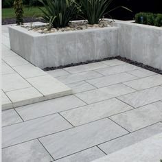 "According to ""Garden Rescue"" tv programme - porcelain garden tiles are really long-lasting/easy to wash down with hosepipe and sounds like they are made of ""real"" material (not concrete)."