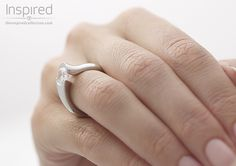 THE RING Soft and dramatic curves of Platinum secure a round brilliant cut diamond – ring pictured features a 2ct diamond. An original design from The Inspired Collection.
