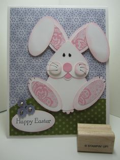Another heart punch used as an adorable bunny head.  Other punches will help you create this easy Easter bunny. Blue and green patterned paper make the background on this handmade Easter card.