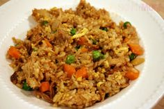 Skinny Chicken Fried Rice... I have made this twice and it is delicious! I use organic brown rice, organic frozen peas, carrots, and corn, as well as fresh organic broccoli that I boil beforehand. I also use 4 eggs because eggs are so yummy! Enjoy!
