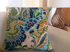 colorful pillows for sofa and chairs for Maureen ........turquoise is her main color so add splashes threw out the home to make it cohesive and flow