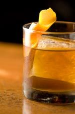 Chocolate Cochon    1½ ounces bacon-infused bourbon  ¼ ounce amaro Ramazotti  ¼ ounce crème de cacao  ¼ ounce kirsch  1 dash of Angostura bitters  To Assemble and Serve  1 orange twist    METHOD  Combine bourbon, amaro, crème de cacao, kirsch, and bitters. Stir and strain into a rocks glass with a large ice cube. Garnish with a flamed orange twist.