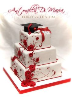 Red Swirl Graduation Cake. I really adore this graduation cake with charming pattern design. The topper is covered with a graduation cap as well as a satin ribbon bow. What I like most is the gumpaste flowers and red swirls.