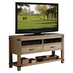 Update the living room or den in classic style with this traditional media console, featuring 2 drawers and an array of open storage for organizing all of yo...