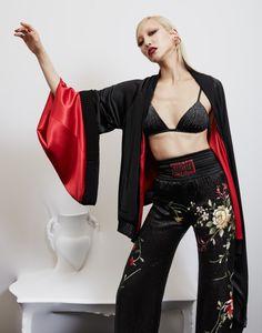 Model Soo Joo Park wears kimono sleeve jacket with floral embroidered pants