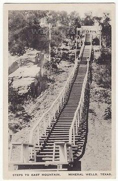 "Mineral Wells Texas Steps to East Mountain Staircase c1930s.  ""After filling up with drink, visitors could take their excercise on the ""Fat Man's Reducer. This early version of the Stairmaster consisted of 1,000 wooden steps that wound up East Mountain"". - See more at: http://michaelwitzel.com/wordpress/mineral-wells-crazy-water/#sthash.QrgZWUsX.dpuf"
