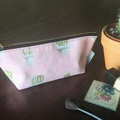 Got my bag with this adorable cactus print on it! I can use it for makeup or even paint brushes! I can't decide... maybe I need to get another one in the pineapple print...  Available here: https://fineartamerica.com/products/mini-cacti-katrina-ryan-pouch.html
