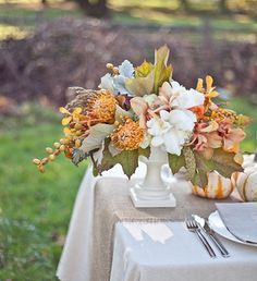 Yummy fall colors...orchids, pincushion protea and maple leaves.