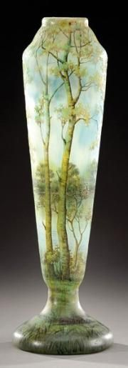 Daum Nancy~Enlarged vase on foot in cameo glass~Acid etched and enameled with a forest landscape and lake Circa 1910