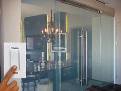 switchable privacy glass room divider with sliding herculite doors
