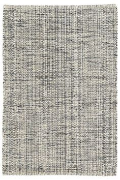 Indigo, grey, and ivory yarns are mixed and woven together to create the unique marled effect of this woven cotton area rug, a perfect fit for the bedroom, office, living room, or stairs.
