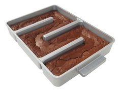 The best brownies have moist centers, a paper-thin crackly crust, and lots of chewy edges. If you agree, you'll love the Edge Brownie Pan™. It's the only gourmet brownie pan that adds two chewy edges to every serving. Brownie Pan, Brownie Recipes, Beste Brownies, How To Make Brownies, Best Pans, All I Ever Wanted, Macaron, Cake Pans, The Best