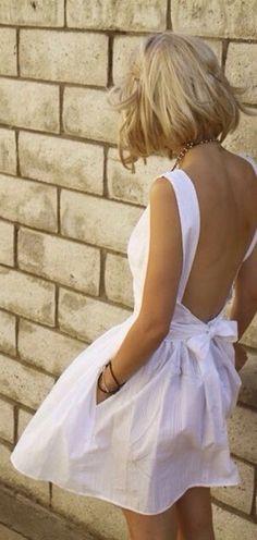 Lovely white backless dress.