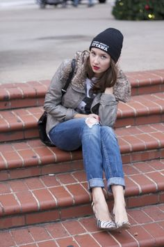 winter style - faux leather jacket, black beanie, distressed jeans, zebra pumps