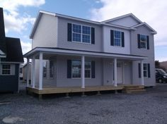 This 2-story home has plenty of space throughout! Take a virtual tour of the interior online and contact us with any questions you have! Two Story Mobile Homes, Two Story Modular Homes, Wood Window Sill, Moble Homes, Whole House Fan, Home Financing, Interiors Online, Building Systems, Display Homes