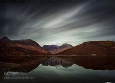 http://500px.com/photo/190451917 Clouds Over Glencoe by matt-anderson -Just got back from 2 weeks of traveling all around Scotland. An experience that turned out to be one of the most wonderful trips to date. I learned it could take a decade or more to fully immerse yourself into it's boundless beauty. Image description: Glencoe Village on the southern bank of the River Coe where it enters Loch Leven in the Lochaber area of the Scottish Highlands. In the distance you can see the Mountains of…