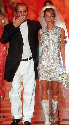 Moss with Gianni Versace on the catwalk during Paris Fashion Week in 1995