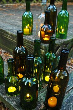 Recycle wine bottles or glass bottles in general and pair them with candles.