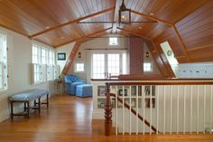 Dutch Colonial - Inside the gambrel roof of this Dutch Colonial revival home, you can see how the four slopes of the roof are split symmetrically down the middle of the central ridge beam, and how much usable space this roofline provides...