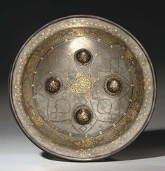 A QAJAR GOLD DAMASCENED WATERED STEEL SHEILD (DHAL)   IRAN, 19TH CENTURY