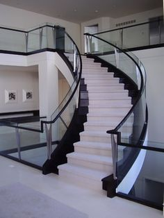 Curved Staircase With Glass Balustrade modern-staircase