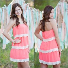 Fun coral dress that would be absolutely darling with boots! Love how the dress trickles down with layers trimmed in lace!