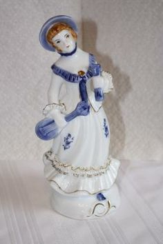 "Vintage porcelain girl figurine 8 1/4"" x 3""D **ruffle on arm broken** $6.50"