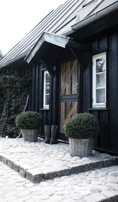 lovely cobbling and the door is so beautifully simple. I want a home where my wellies live just outside the front door.
