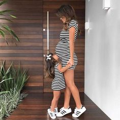 Include your oldest daughter in your pregnancy with these matching striped dresses. Striped maternity dress and little girl striped dress. I love mommy and me matching outfits! Cute Maternity Outfits, Stylish Maternity, Maternity Fashion, Maternity Dresses, Maternity Clothing, Nursing Outfits, Spring Maternity, Maternity Nursing, Maternity Style