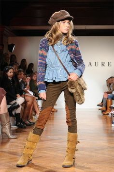 """Ralph Lauren and SAKS started New York Fashion Week off with a miniature runway show (as far as the models and audience members go) displaying 34 looks for the fall and holiday season. Instead of the usual stylist, fashion journalist, or A-list celebrity snagging that coveted front row seat, young girls lined the catwalk - little fashionistas and """"buyers"""" in their own right. Ralph Lauren himself even made a special surprise appearance at the end of the show. Ahh, to be a kid again."""