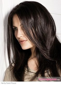 Tones of dark chocolate brown are great to make pale, cool skin tones all the more striking. The contrast really shows off a flawless complexion. To prevent such a deep shade from falling flat, add subtle, barely-there highlights that will also make this dark brunette easier to pull off.