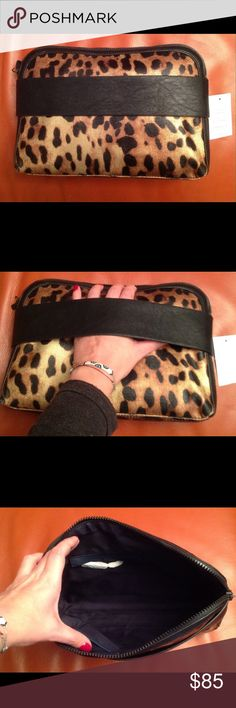 FRENCH CONNECTION CLUTCH AUTHENTIC FRENCH CONNECTION DREAM BOAT CLUTCH. Beautiful coated leopard fabric. With plastic full zipper opening. Leather solid black fabric along opening and on slide through strap. Inside zipper and cell phone pockets. Very roomy. Brand new French Connection Bags Clutches & Wristlets